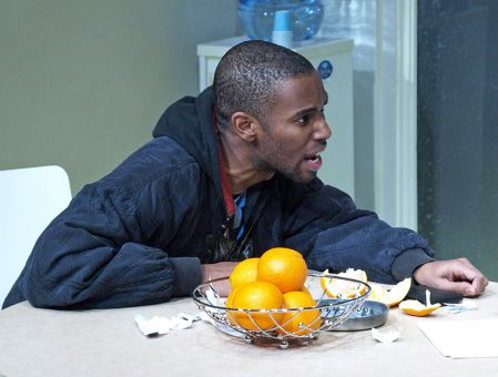 Ayinde Blake plays Christopher, a patient who is believed to have schizophrenia due to his hallucination that the oranges on the table are blue, not orange.
