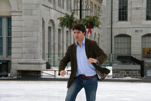 Trudeau takes a moment from greeting supporters at Kingston's Market Square for a quick slide on the ice.