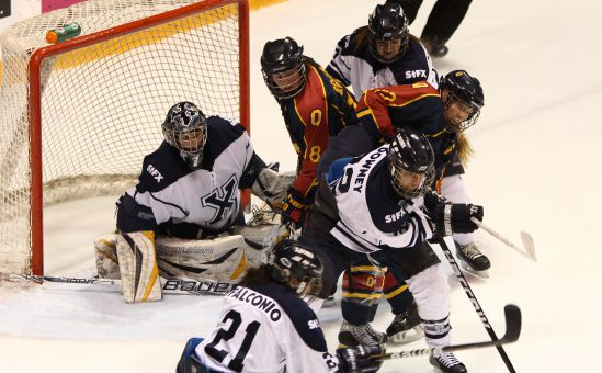 Gaels forward Shawna Griffin (18) and defender Katie Duncan battle in front of the St. FX net.