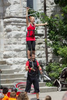The Street Circus wows audiences with daring stunts.