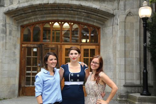 Victoria Condlln, a former Queen's student, Evelyn Popiel, ArtSci '14, and Aimee Bouchard, ArtSci '13, pose outside of Kingston Collegiate and Vocational Institute, which was the first space used in a Colliding Scopes production.