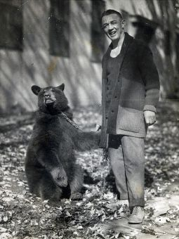 Trainer Billy Hughes poses alongside the original Boo Hoo the Bear.