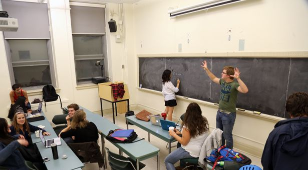 The 2013-14 Queen's Players troupe holds an animated rehearsal for their upcoming season.