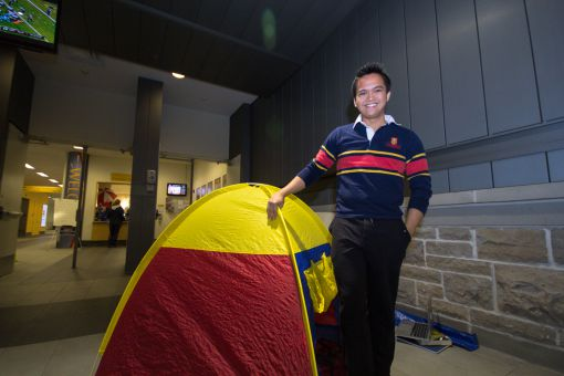 Jaril Valenciano brought a tricolour tent to camp for student football tickets inside the Queen's Centre on Monday night.