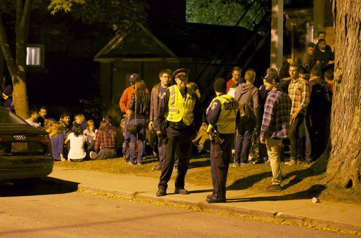 Police patrol Aberdeen St. on Saturday night to keep the Homecoming parties under control.
