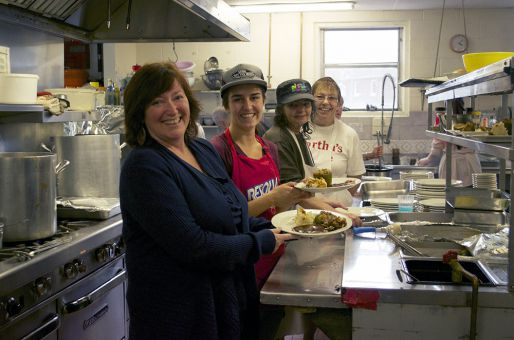 Ronda Candy, left, prepares a dinner with volunteers at Martha's Table.