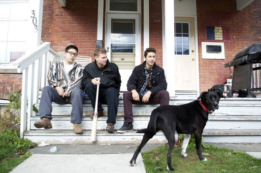 The trickster dog, Layla, and her housemates hang outside of their house on Earl St.