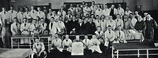 The Faculty of Medicine's Class of 1926 poses with their beloved skeletons and cadavers.
