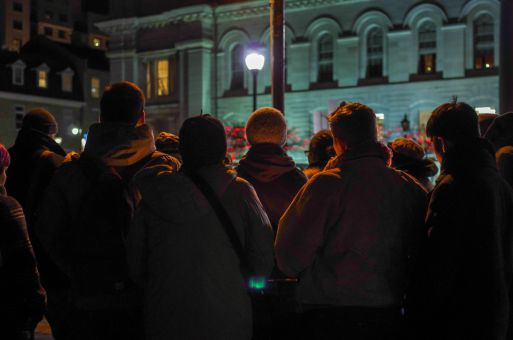 Kingston residents gather in front of City Hall Wednesday night.