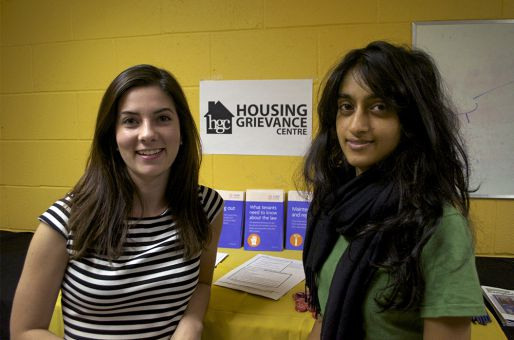 Catherine Wright and Sangeeta Raju, ArtSci '14, inform students about tenant rights.