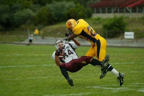 Tracey's defences were often top in the OUA, featuring lineman John Miniaci (top) and this blistering hit from 2007 (bottom).