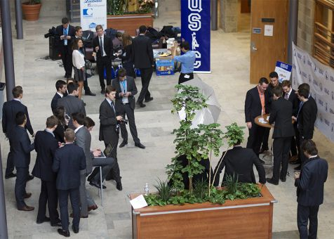 Delegates emerged from breakout rooms and convened in the Goodes atrium to sign their unofficial contracts.