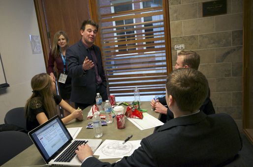 In Saturday's free agency simulation, QSIC student delegates assumed the roles of players, agents and team executives and negotiated mock million-dollar contracts.