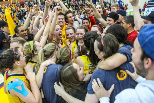 The Gaels withstood a last-second, game-tying shot to win in overtime and clinch their first division championship since 2003.