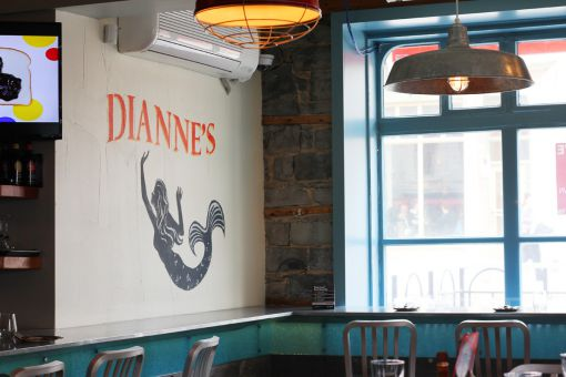 Mermaids make a splash on the interior walls of Dianne's Fish Bar.