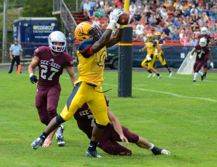 Wide receiver Curtis Carmichael snags a touchdown pass in the second quarter, one of his eight grabs on the day.