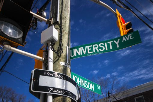 Decommissioned street signs from before the University District rebranding are being sold at auction.