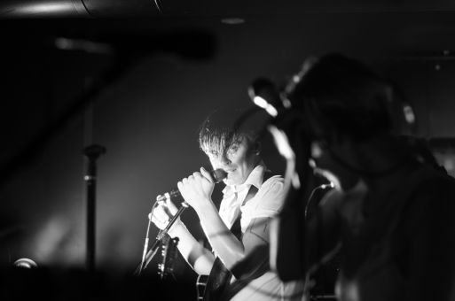 July Talk's lead singer performing for a lively crowd at The Underground.