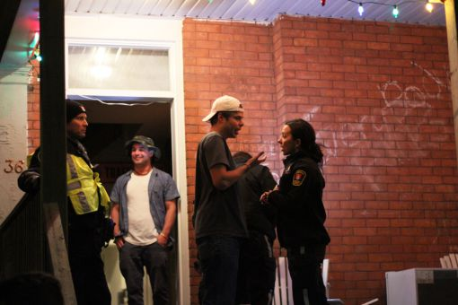 A Kingston Police officer talks to students on Aberdeen St.