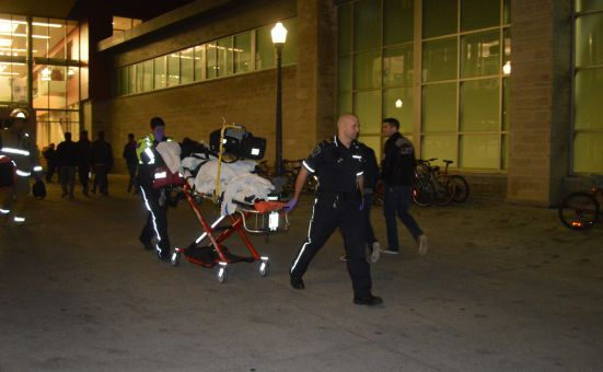 A young woman was removed from the Queen's Centre on a stretcher.