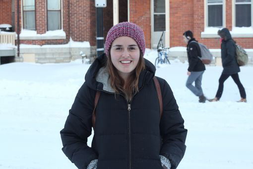 Emily Graham, a co-president of Queen's Backing Action on Climate Change, organized a march on Richardson Hall to present a petition for divestment to the Board of Trustees.