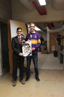 """Alexander Savides and Stephen Penstone with their """"5-OH and Go Vote"""" campaign poster."""