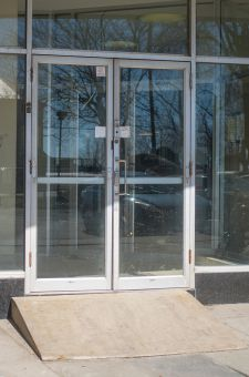 The main entrance at Waldron Tower is wheelchair accessible, but lacks an automatic door.