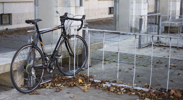 A bike locked to a bike rack