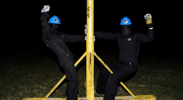 "Members of U of T's ""Brute Force Committee"" pose with EngSoc's grease pole."