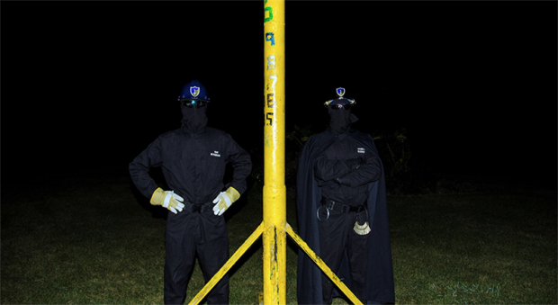 "Members of U of T's ""Brute Force Committee"" pose with EngSoc's grease pole"