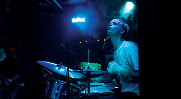 Viet Cong drummer Mike Wallace performing onstage.