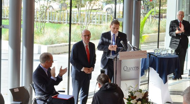 Principal Daniel Woolf (right) and Stephen Smith (left) unveiled the new name of the Smith School of Business at Goodes Hall on Thursday morning.