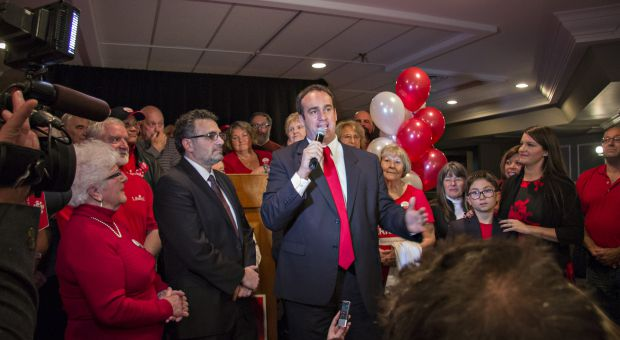 Liberal candidate Mark Gerretsen (center) will be the MP for Kingston and the Islands.