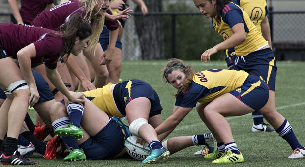 Dominique Rumball (centre) has been a major reason in propelling the women's rugby team to in the OUA bronze medal game.