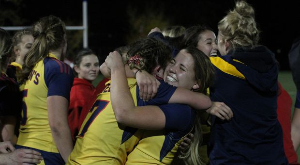 Lauren Murray (right) celebrates after the Gaels' quarterfinal win.