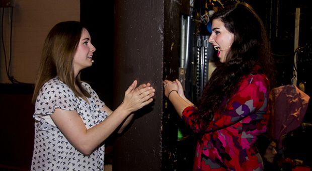 Actors Keli Jay (left) and Sydney Kowal at a dress rehearsal for Queen's Students on Broadway's fall show Sex, Drugs, and a Proper Education.