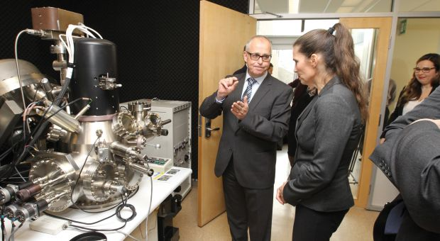 Gregory Jerkiewicz (left) took Kirsty Duncan, Minister of Science (right) on a tour of his lab which was just rewarded a $4-million grant.