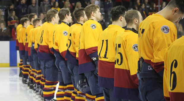 Gaels players line up for the pregame national anthems.