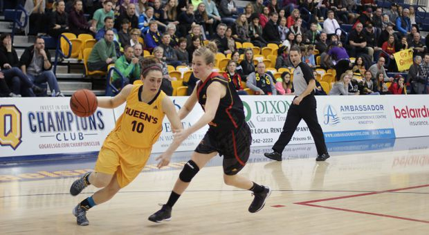 Marianne Alarie (left) carries the ball against Guelph.