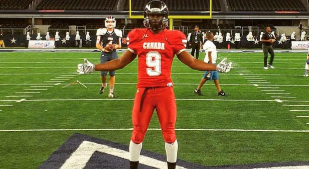 Chris Osei-Kusi poses at midfield of AT&T Stadium.