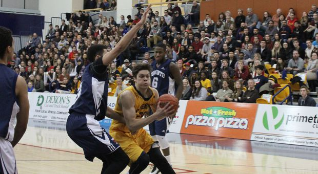 Ryall Stroud carries the ball towards the basket for the Gaels.