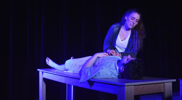 Erica Hill (top) and Zach Closs (bottom) performing in Gruesome Playground Injuries.