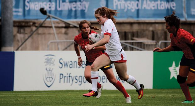 Emma Chown (white shirt) playing her first games for Canada Rugby 7s in Wales.