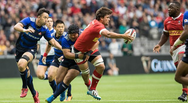Rumball (center) playing with Rugby Canada against Japan.