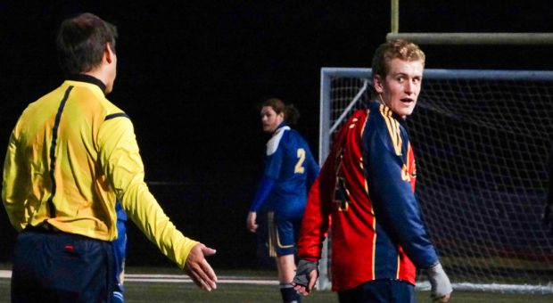 Defender Sam Abernethy argues with a referee during the Gaels hotly-contested 1-0 victory against the Laurentian Voyageurs on Wednesday.