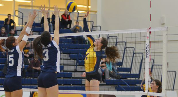 Isabelle Birchall spikes the ball against U of T.