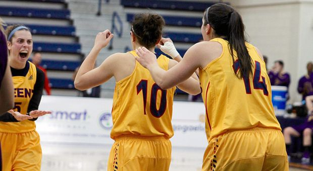Emily Hazlett (left) and Marianne Alarie (10) celebrate against Laurier on Friday. Alarie scored 39 points over the weekend in the Gaels' two wins.