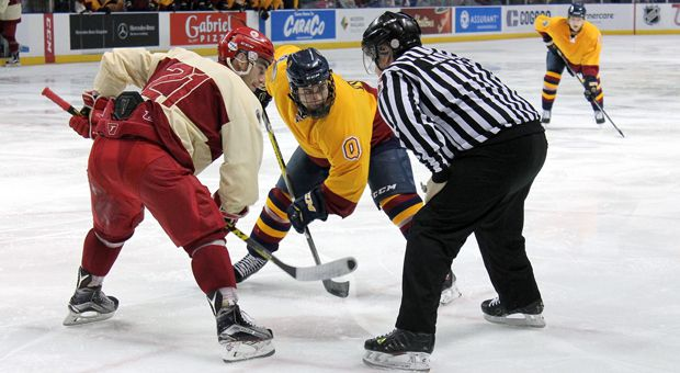 Darcy Greenaway (right) at the face-off circle in the Gaels 3-2 loss.