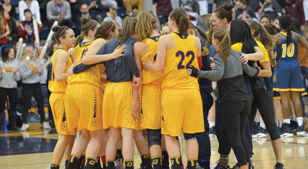 The women's basketball team celebrating at the OUA Final Four.