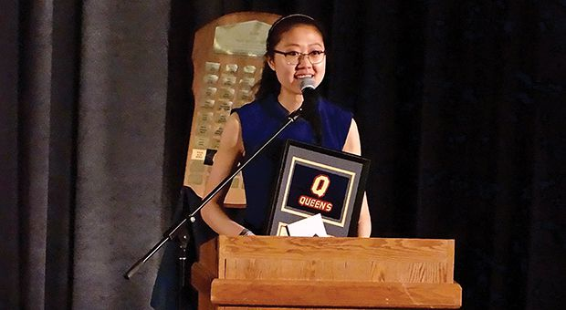 Lily Jiang accepts the Marion Ross Trophy.